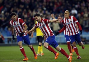 Atletico Madrid's Villa celebrates his goal against Sevilla during their Spanish First Division soccer match at Vicente Calderon stadium in Madrid